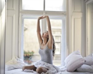 Young woman stretching in the morning