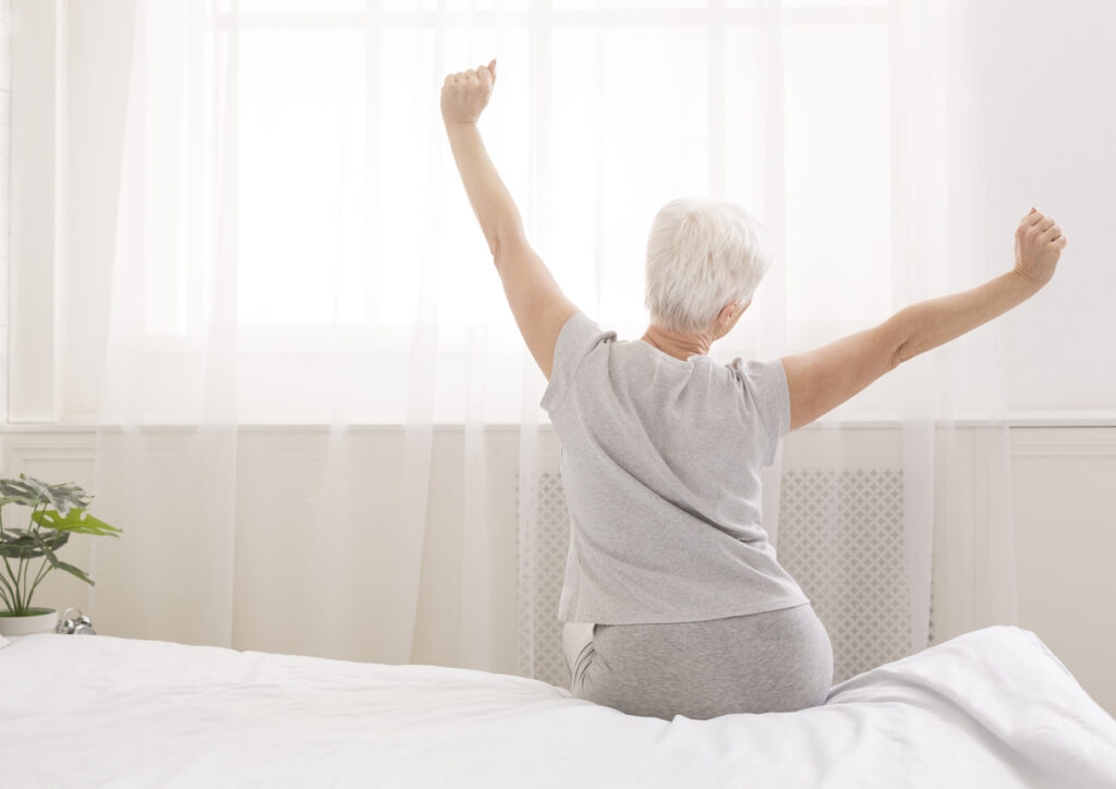 Elderly woman stretching for joint pain