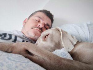 man asleep with his dog